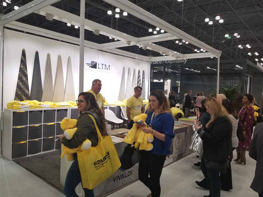 SUNY Adirondack students Meaghan Colin and Samantha Hamelin talked with representatives from LTM Textiles during the HX2018 conference in New York City.