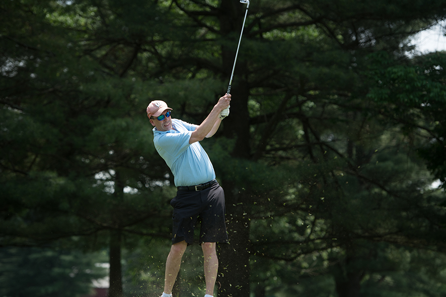 Michael Bittel, executive director of the Adirondack Regional Chamber of Commerce, takes a swing during the 2018 Lyman A. Beeman Jr. Annual Golf Tournament.