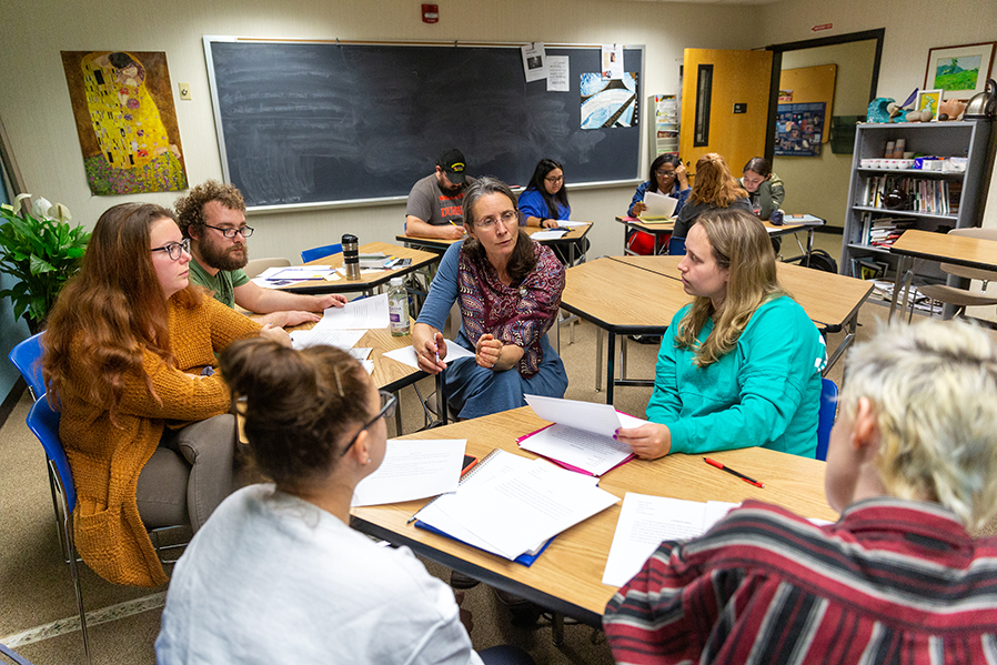 Distinguished Professor of English Lale Davidson works with students on a writing assignment.