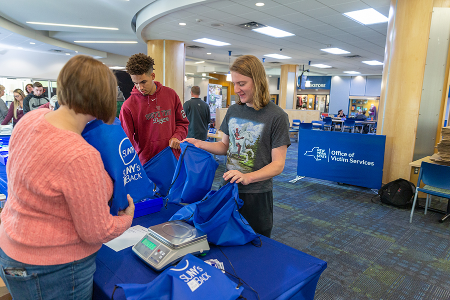 Volunteers assemble comfort kits for domestic violence victims during a SUNY's Got Your Back event in the Student Center.