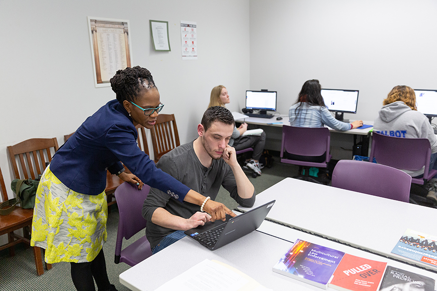 Assistant Professor of English Donna Hayles assists a student with a class assignment.