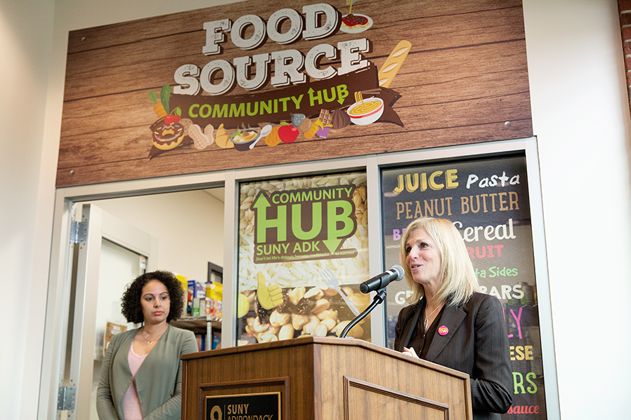 Dr. Kristine Duffy, right, and Community Hub Coordinator Yasmin Lopez officiate the grand opening of the Food Source in November 2017.