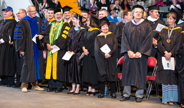 Faculty members at a graduation ceremony
