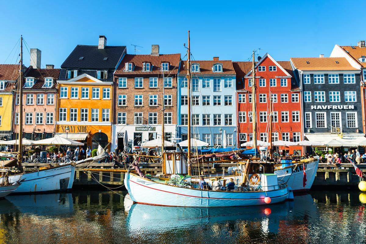 Image of boats on water in front of colorful buildings in Copenhagen