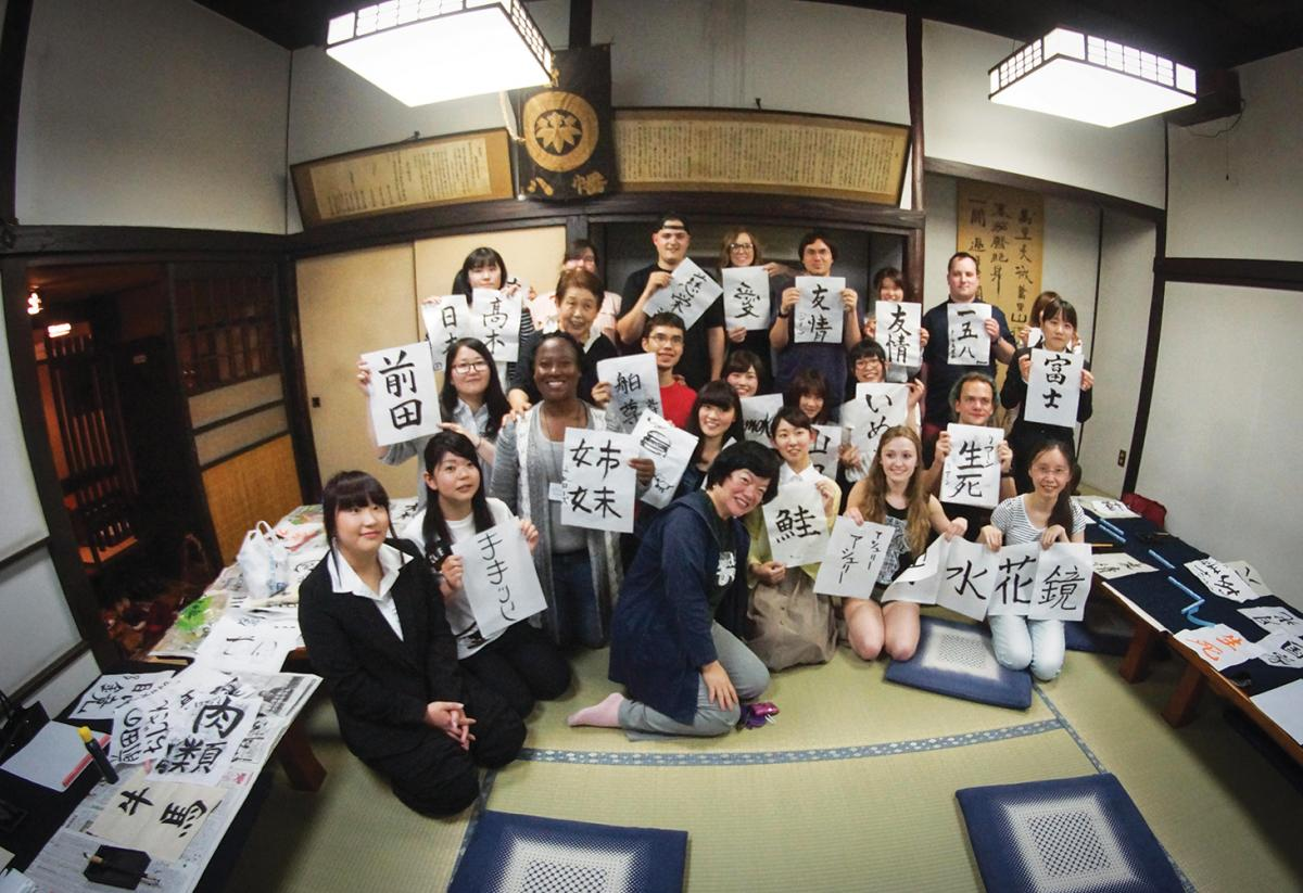 SUNY Adirondack students holding their japanese letter writing during a trip to Japan