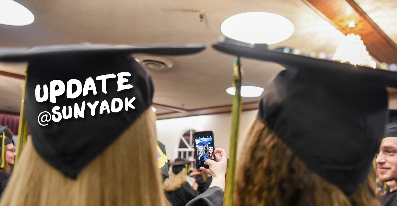 Two female students taking a selfie at graduation