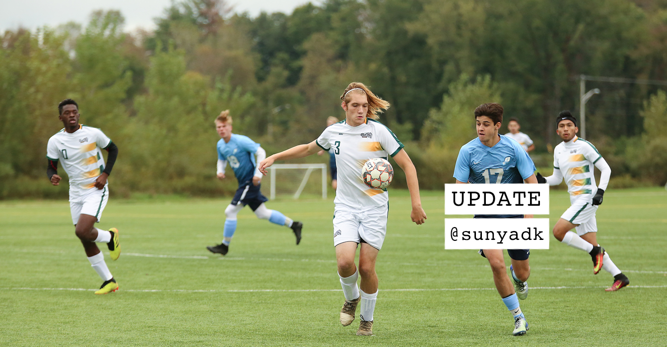 Men's Soccer team playing against another college