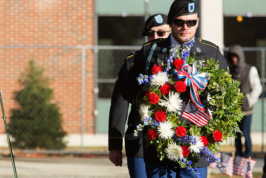 Jesse Vise, front, and Bradley Perry of the SUNY Adirondack Veterans Club take part in the presentation of the wreath during a Veterans Day ceremony on the college campus.