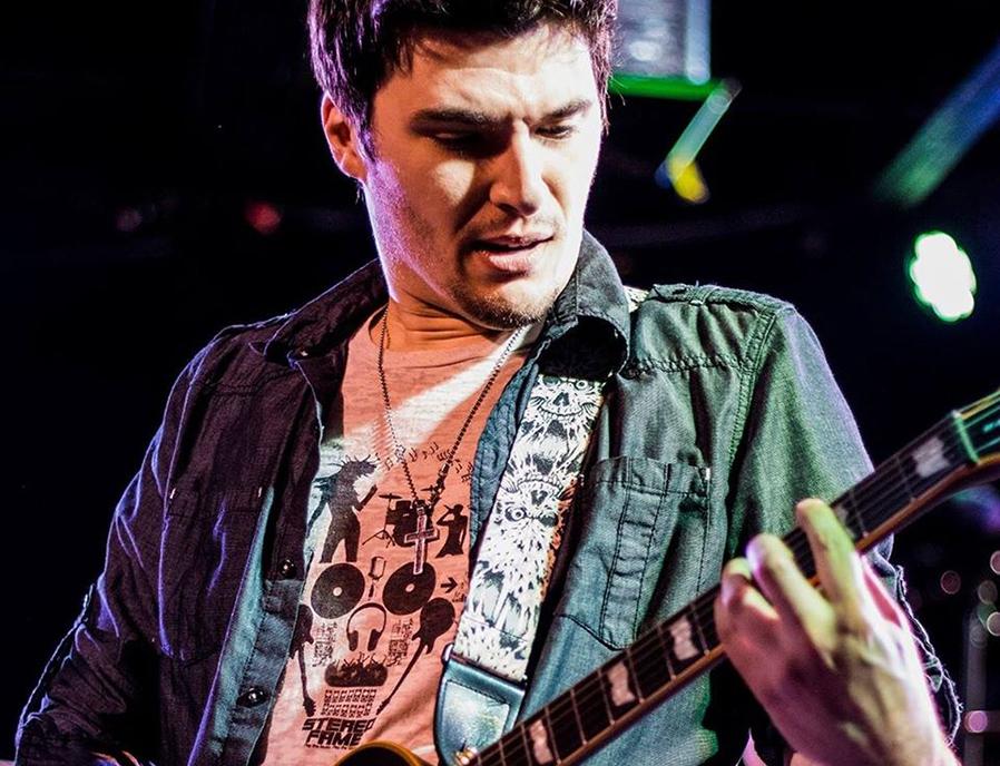 Frank Palangi plays the guitar.