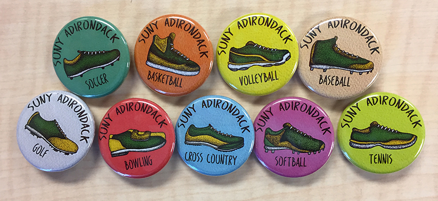 Buttons promote various SUNY Adirondack athletic programs.