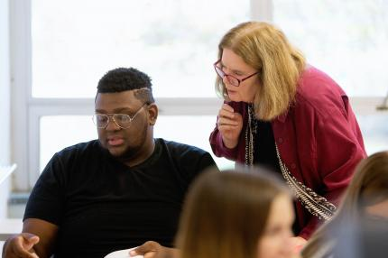 Professor LaPann instructing a student.