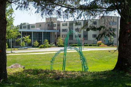Zirbes sculpture overlooking residence hall