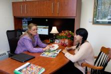 Admissions Director Sarah Jane Linnehan meets with a student