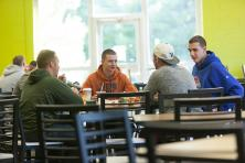 Male students eating in the dining hall