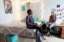 Two female students sitting in their dorm room