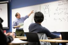 engineering instructor at white board